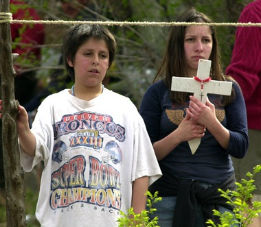 These two young people were among pilgrims arriving at the Santuario de Chimayo on Good Friday 2004. Photograph by Rick Romancito