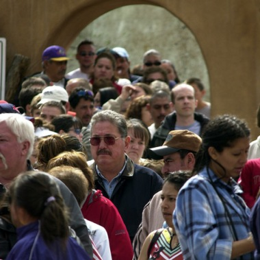 People from all walks of life and from all over the region line up to enter the world famous Santuario de Chimayo on Good Friday 2004. Photograph by Rick Romancito